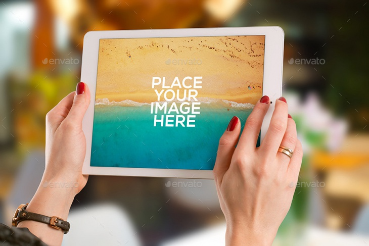 in hand photorealistic ipad mockup