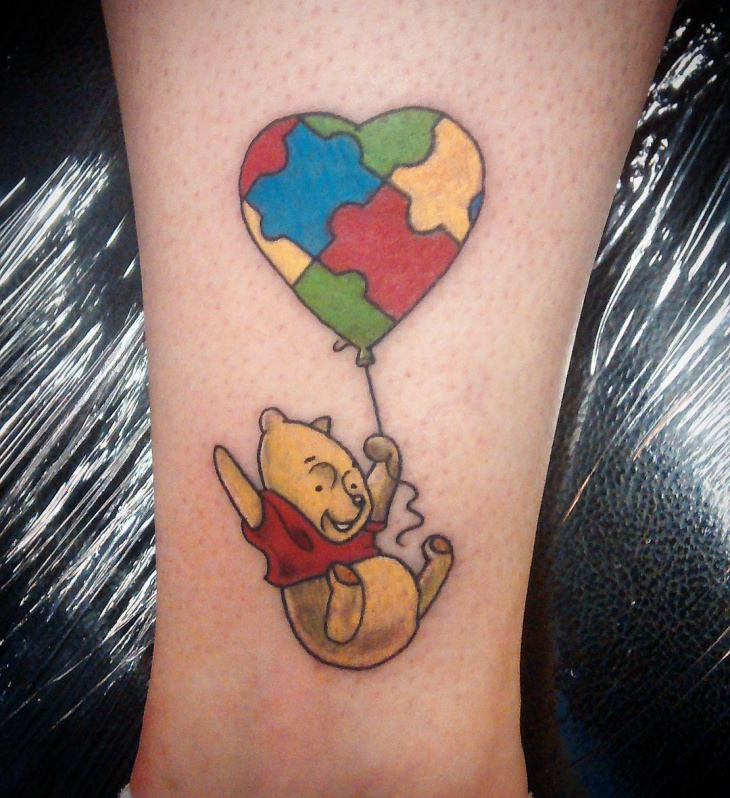 puzzle autism cartoon tattoo