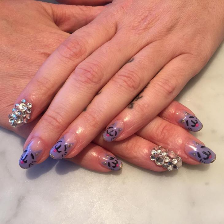 purple rhinestone festive nail art