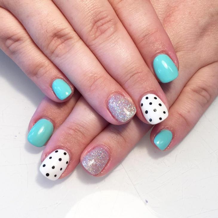 black polka dot nail design