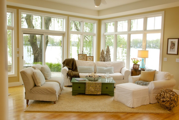 lake view living room with glass wall
