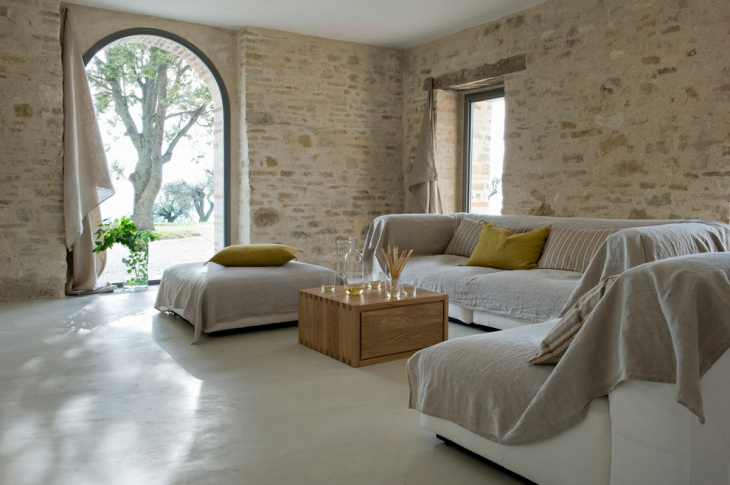 Mediterranean Living Room with Stone Wall
