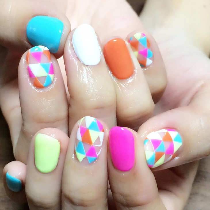 geometric nail art with neon colors