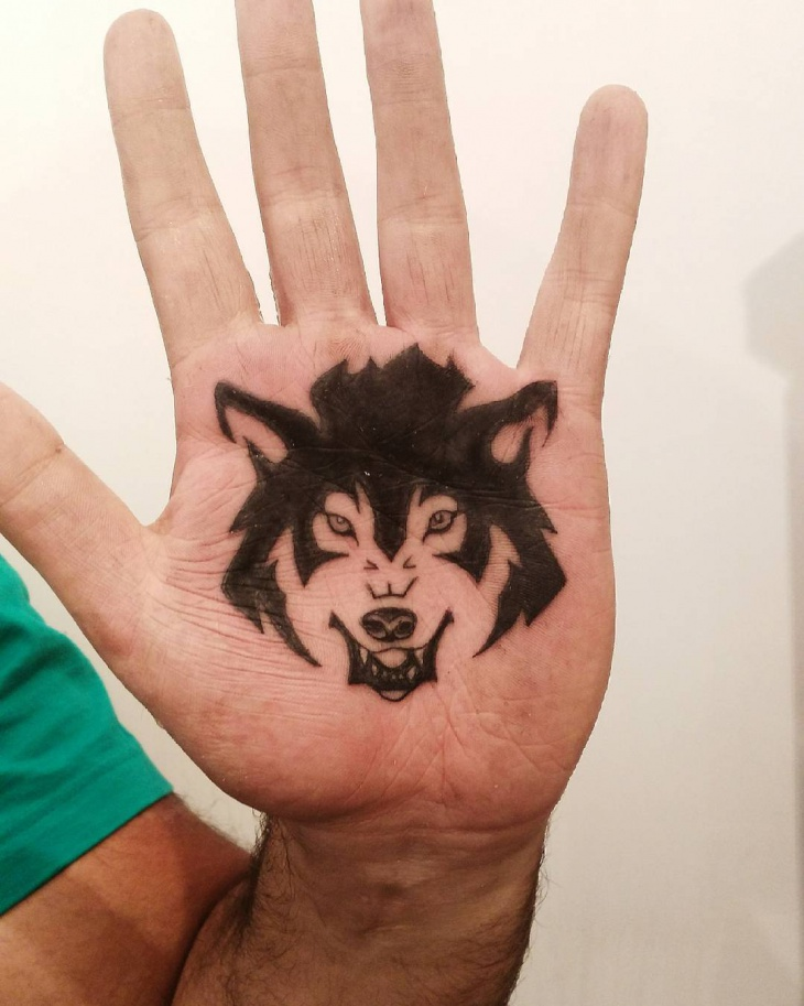 black wolf palm tattoo