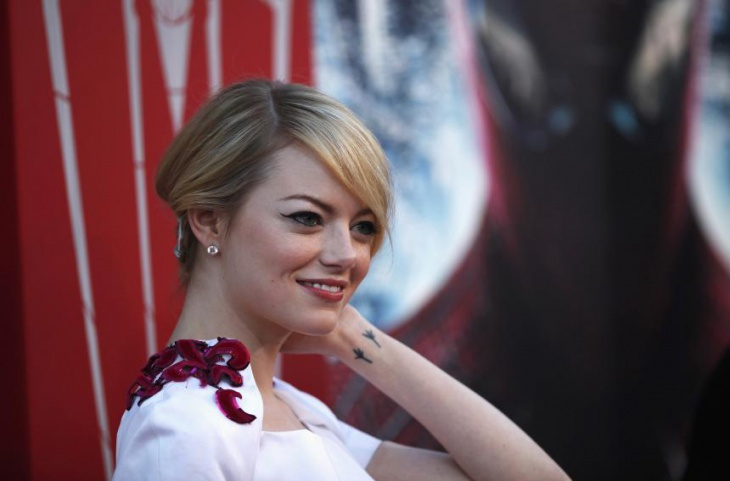 emma stone wrist lilly tattoo