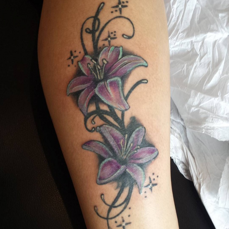 purple color flower tattoo