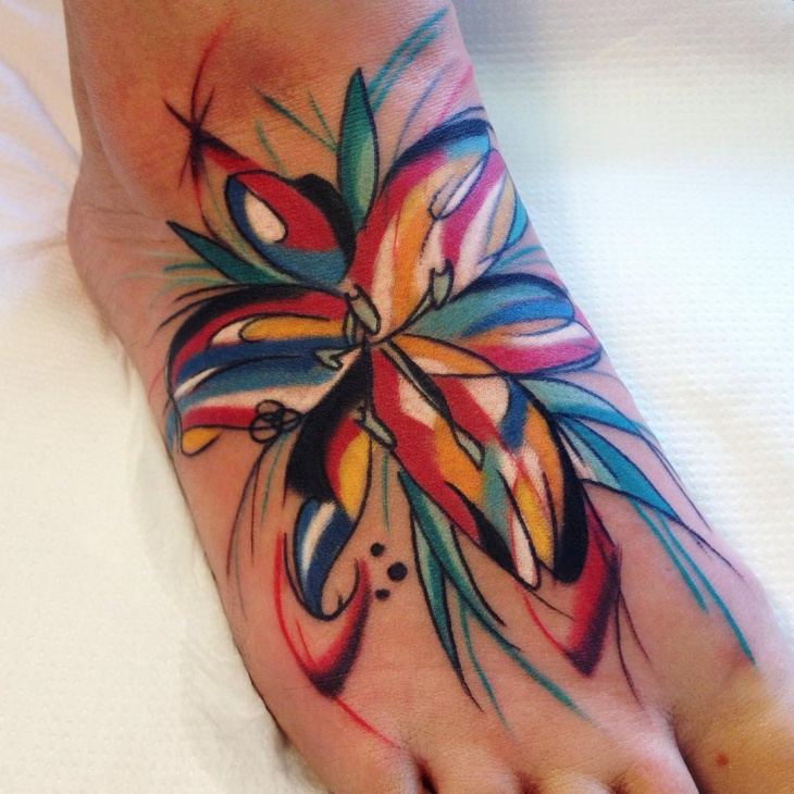 colorful lily tattoo on foot