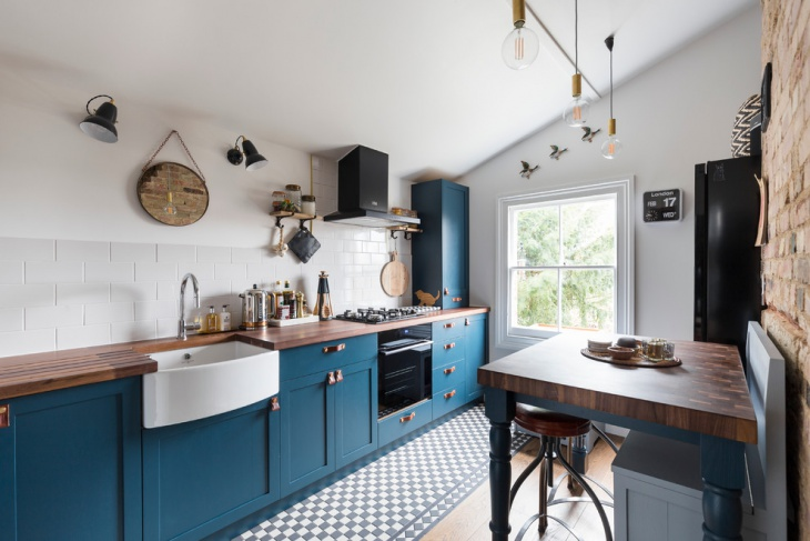 amazing kitchen with blue cabinets