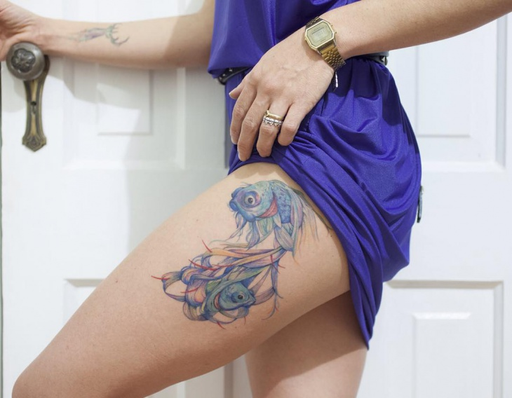 pisces thigh tattoo design