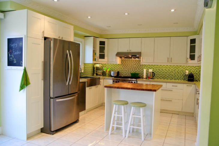 White Marbled kitchen green wall tiles design