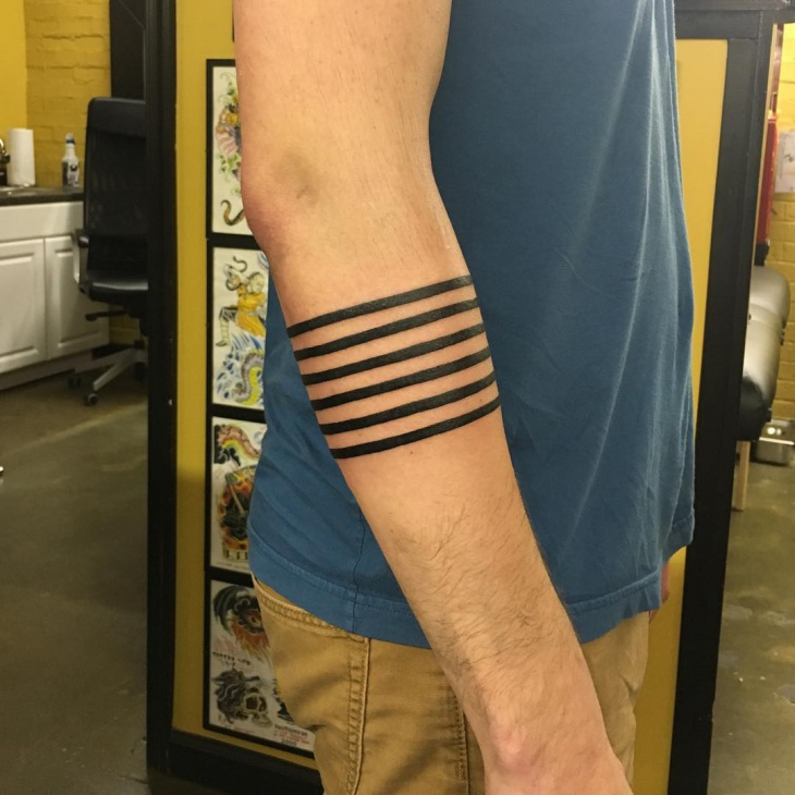 Lower Arm Black Tattoo