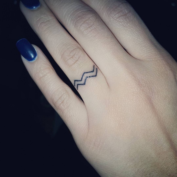 Aquarius Finger Tattoo