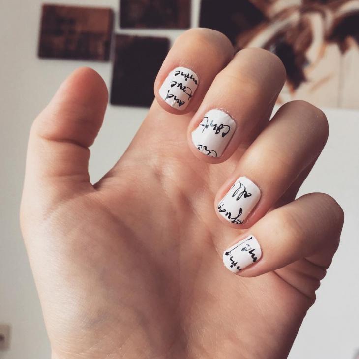 Cursive Newspaper Nail Design