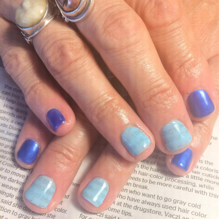 Dark Blue Newspaper Nails