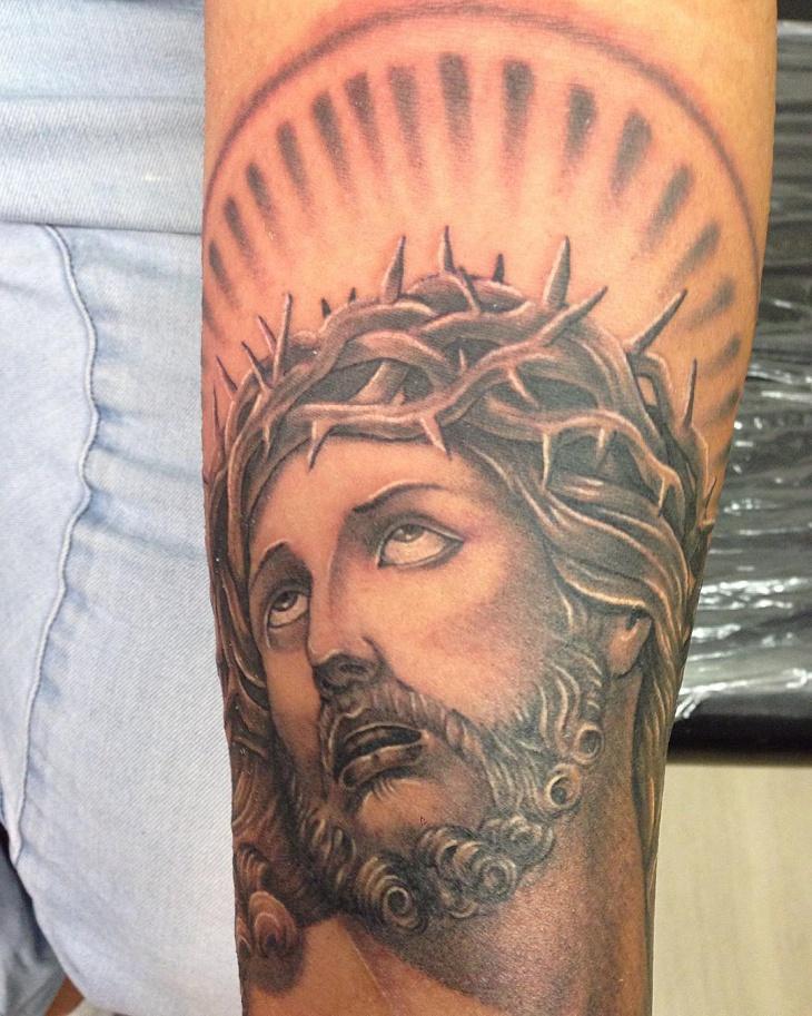 black and grey jesus hand tattoo