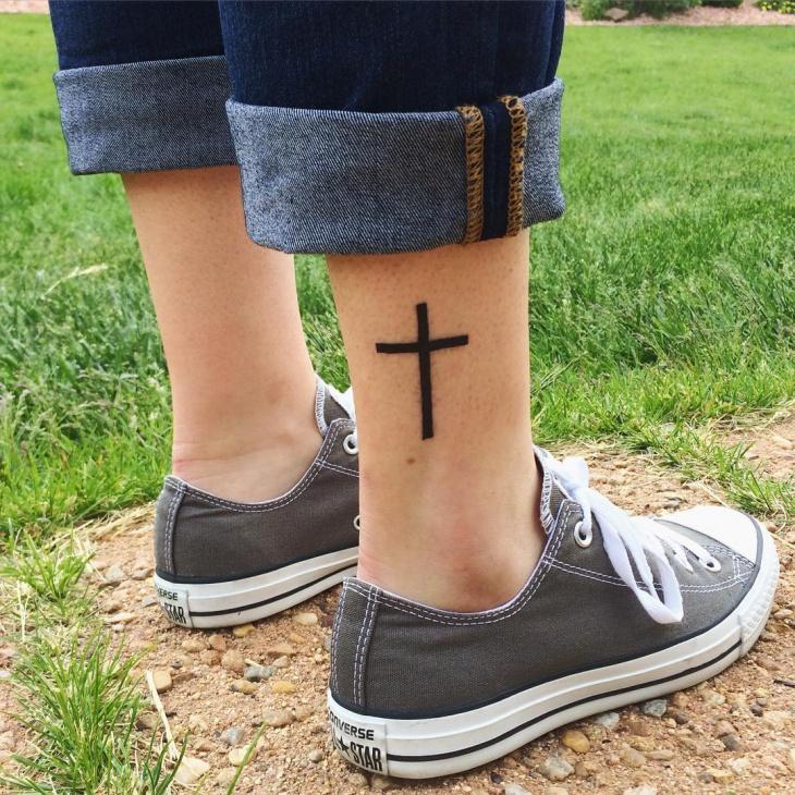 black cross leg tattoo