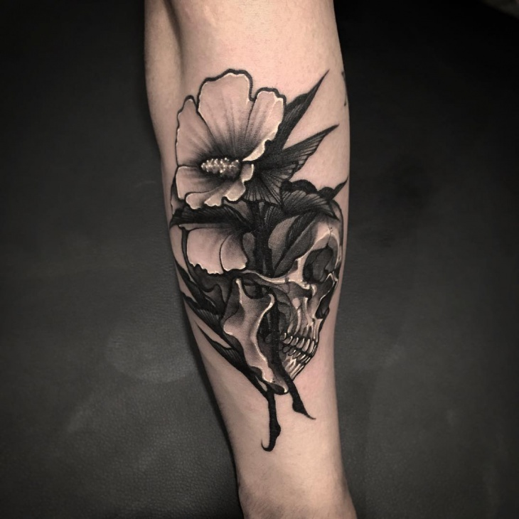 black art work flower tattoo