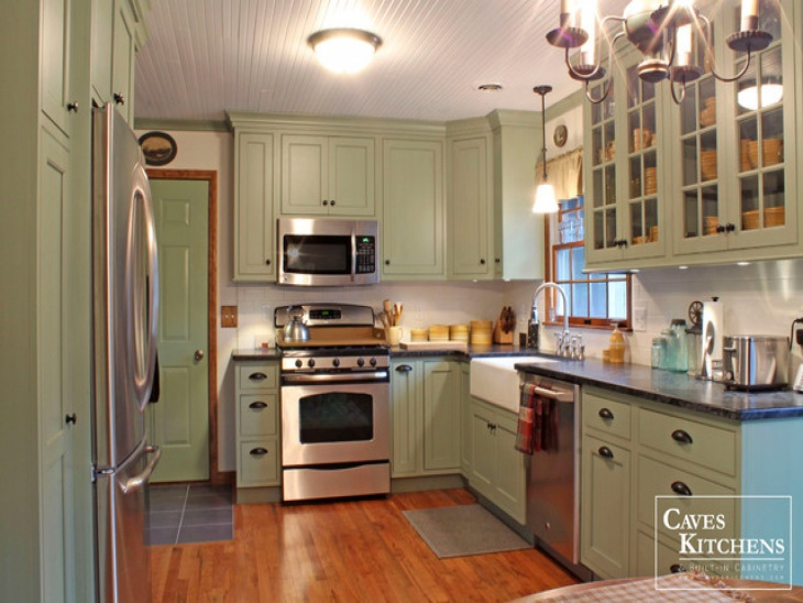 cottage green kitchen storage with farmhouse sink