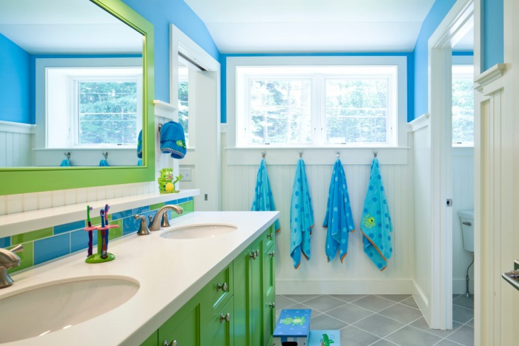 beach style bathroom with green cabinets