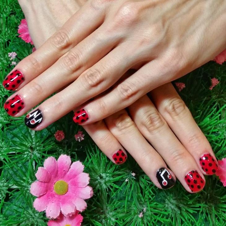 red polka dot nail design