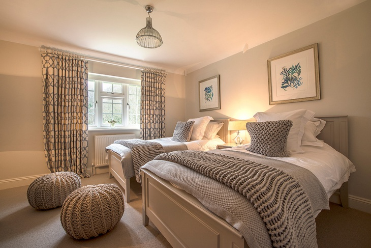 stylish double beds with woollen blankets