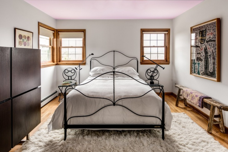 eclectic bedroom with metal bed