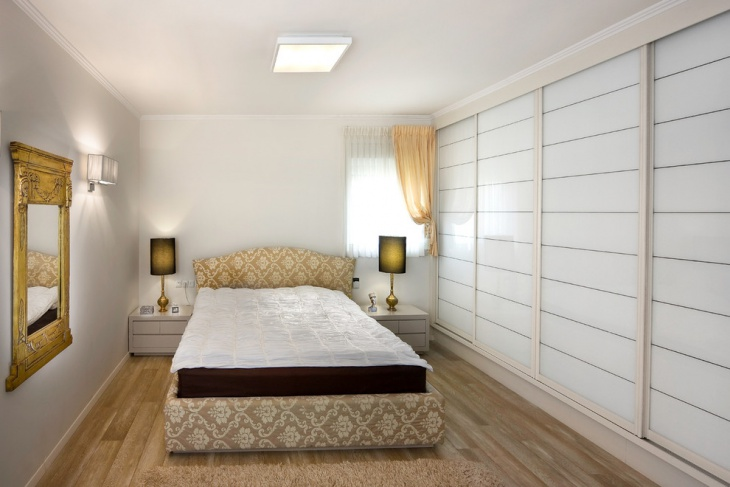 spacious bedroom with bedside lamps