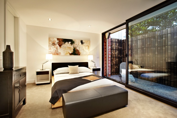 modern bedroom with glass sliding door