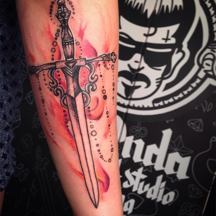 watercolor dagger tattoo