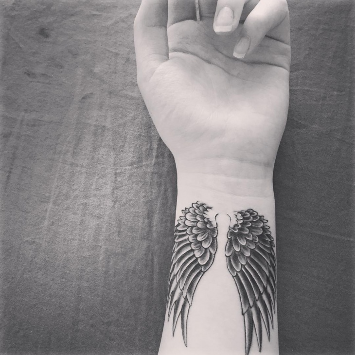 angel wing tattoo on wrist