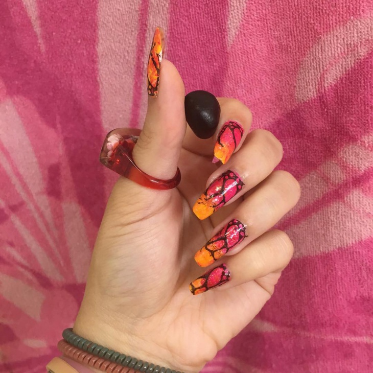 yellow and pink sunset nails
