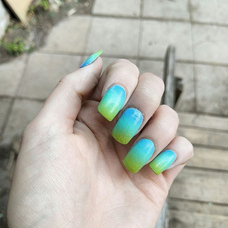 green and blue acrylic nail design