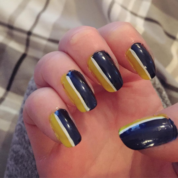 yellow and blue striped nail art