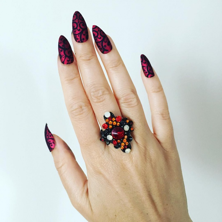 red and black floral print nail design