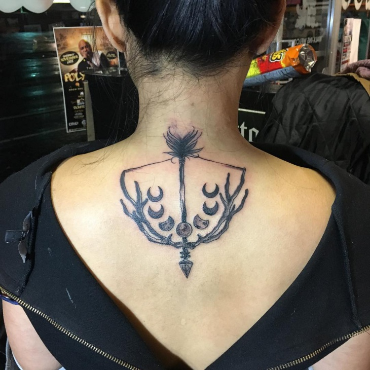 bow and arrow antler tattoo