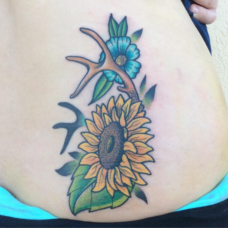 sunflower with antler tattoo