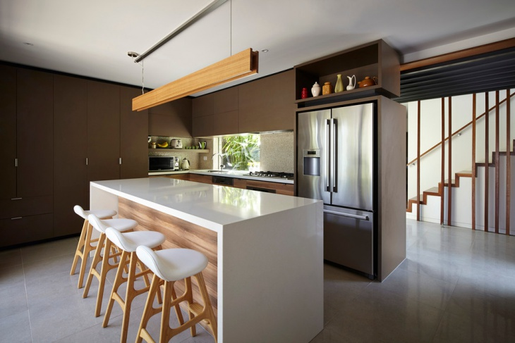 Contemporary Brown Kitchen with white Dining