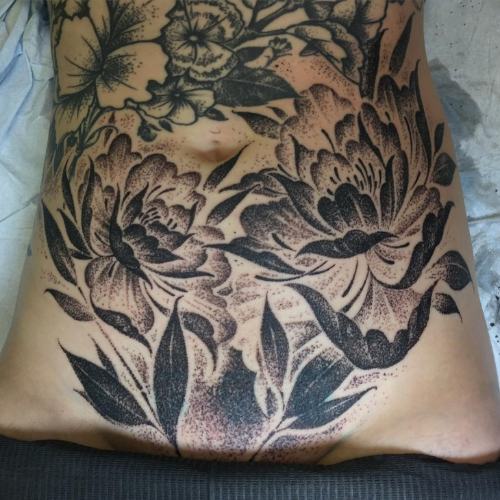 floral tattoo on stomach