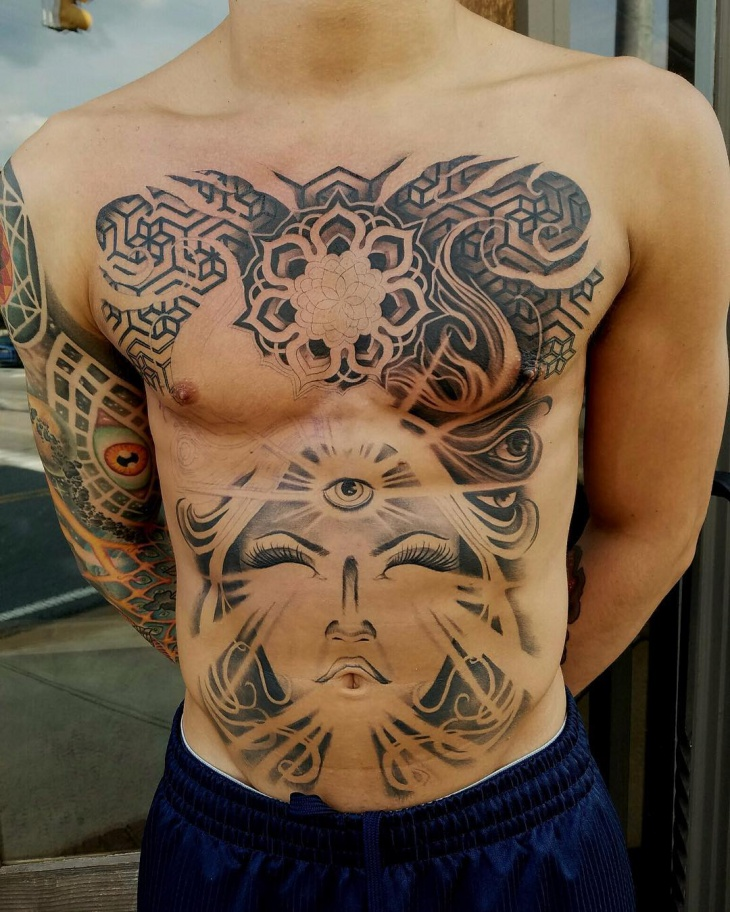 beautiful tribal stomach tattoo