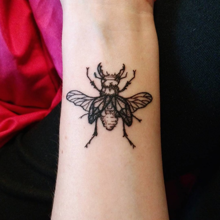 Stag Beetle Wrist Tattoo