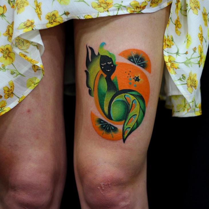 Orange Tattoo on Leg