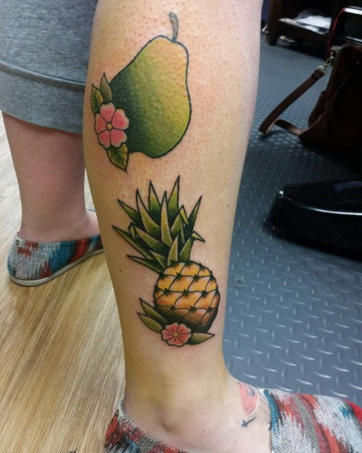 flower with fruit tattoo on leg