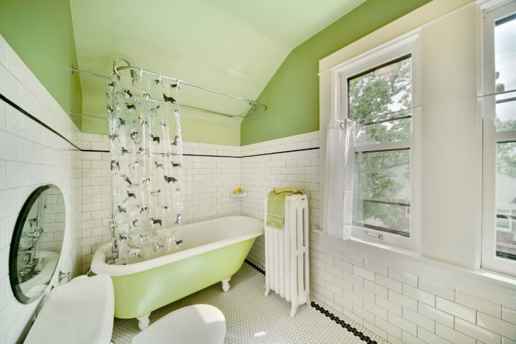green wall with white and black bathroom design