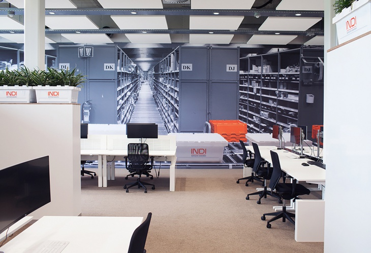 open office renovation with wall art