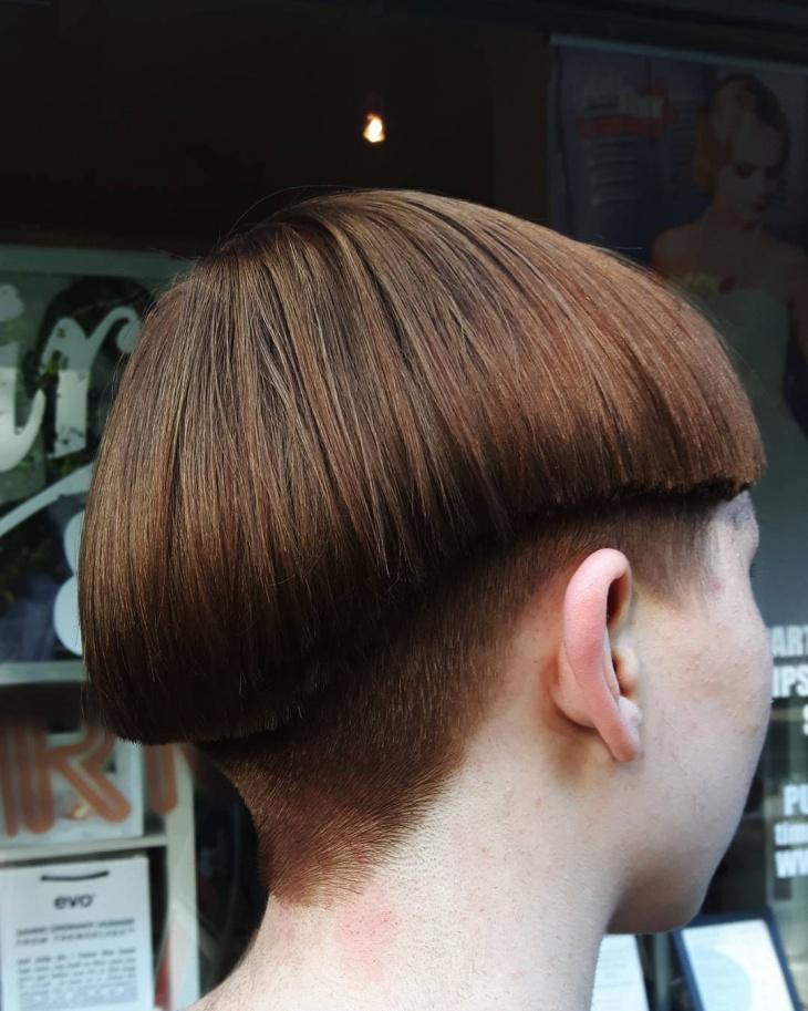 silk and shiny bowl haircut