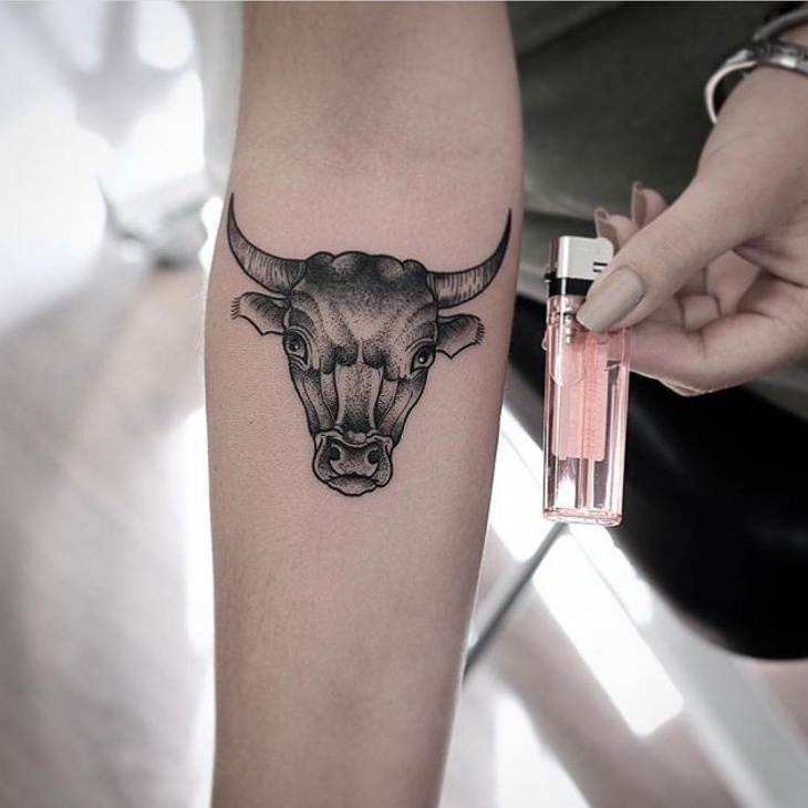 bull head tattoo on arm
