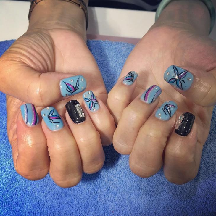 Rhinestone Lily Nail Design Idea