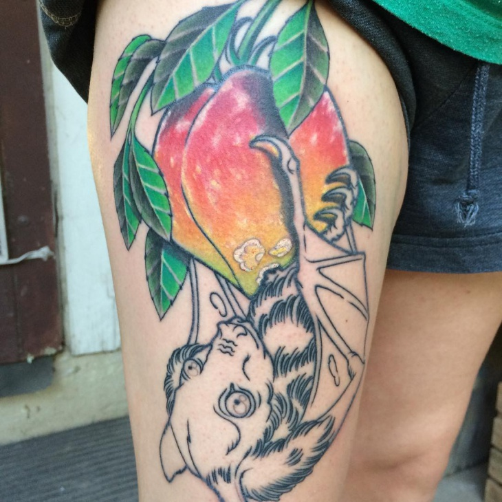 colorful peach tattoo on thigh