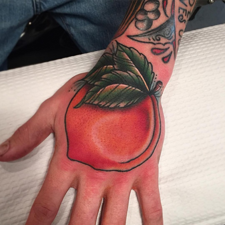 beautiful peach tattoo on palm