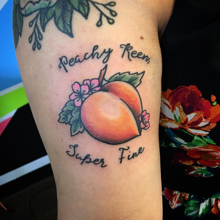 peach tattoo on arm